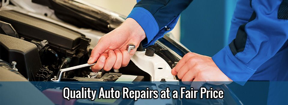 Quality Auto Repairs at a Fair Price – mechanic working on car battery